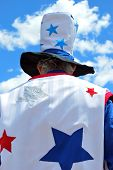 picture of uncle  - Uncle sam standing tall among the clouds outside - JPG