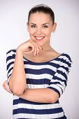image of cross-dress  - Portrait of young beautiful woman in striped dress - JPG