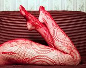 image of fetish fishnet stockings  - woman lying on the couch - JPG