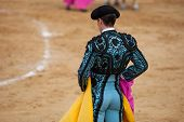stock photo of bullfighting  - The bullfighter wait the bull charge with the capote during a bullfight - JPG