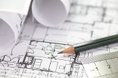 stock photo of draft  - Architect rolls and plans construction project drawing - JPG