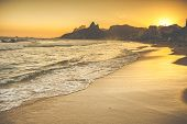 picture of ipanema  - Warm Sunset on Ipanema Beach with People Rio de Janeiro Brazil - JPG