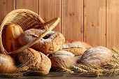 picture of breakfast  - Whole grain wheat bread in basket with wheat ears - JPG