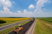 foto of heavy equipment operator  - road making with heavy machines in rural area - JPG
