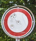 picture of traffic rules  - No vehicles traffic sign with bullet hole - JPG