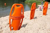 picture of lifeguard  - Lifeguard orange rescue equipment on beach in the summer - JPG