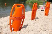 pic of nautical equipment  - Lifeguard orange rescue equipment on beach in the summer - JPG