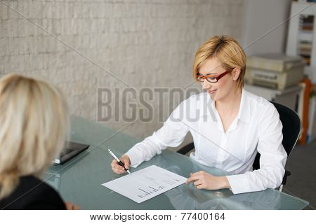 Businesswoman Fill Out A Form In Office