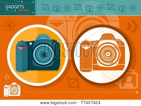 Digital camera in frame on orange background