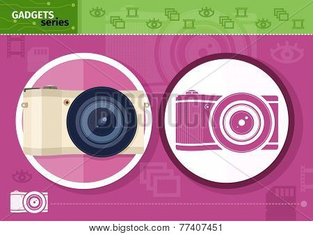 Digital camera in frame on lilac background