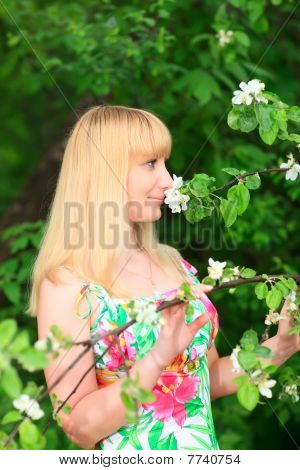 Woman Sniffing Flowers