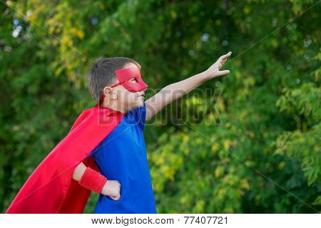 Superhero Standing Sideways And Calling On Forward
