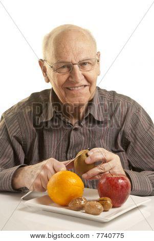 Senior Man Eating Fresh Fruit