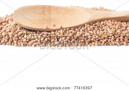 Buckwheat isolated with a wooden spoon on white background