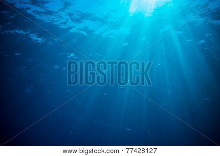 abstract underwater scene sunrays and air bubbles in deep blue sea