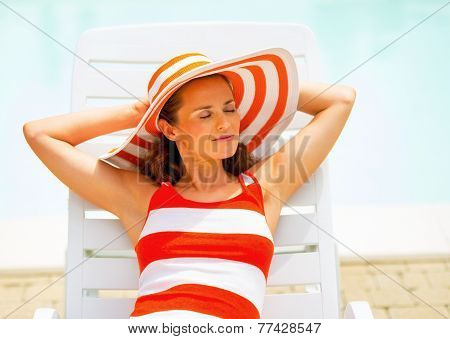 Relaxed Young Woman Laying On Chaise-longue