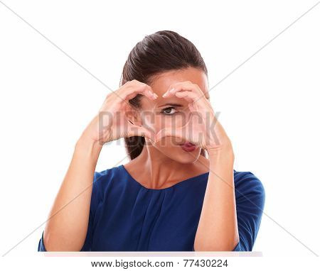 Lovely Hispanic Gesturing A Love Sign