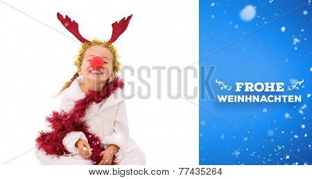 Cute little girl wearing red nose and tinsel against blue vignette