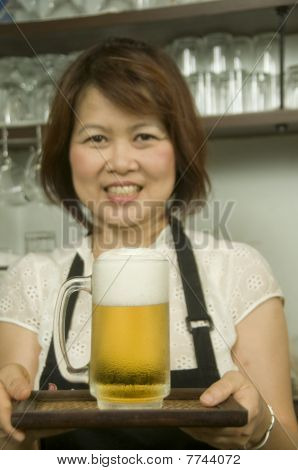 Woman Serving Ice Cold Beer