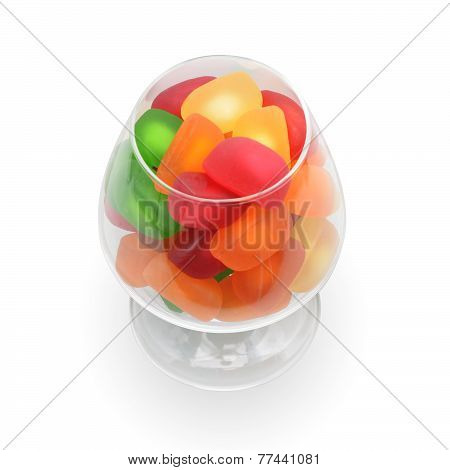 Colorful various candies are in glass goblet.