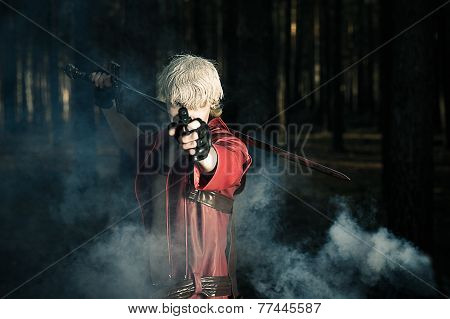 man with a sword and a gun in the hands