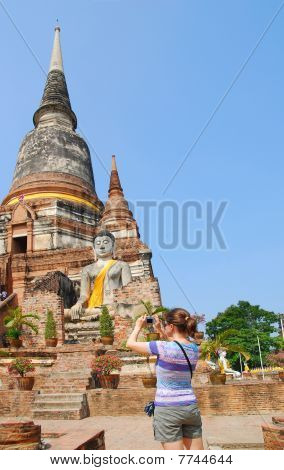Tourist With Camera In Front Of Budhist Stupa
