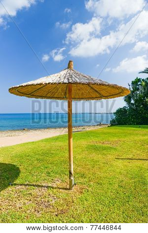 Parasol Of Straw On The Sea