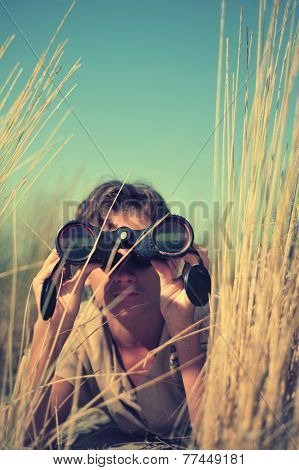 Young Boy Looking Through Binocular, Low Angle View