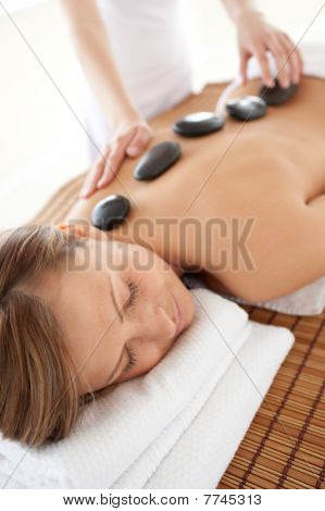 Calm Woman Lying On A Massage Table