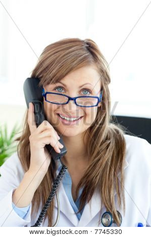 Smiling Female Doctor Talking On The Phone