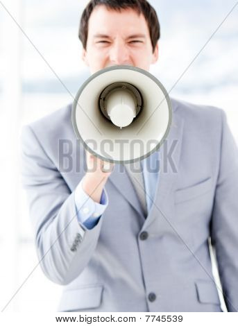 Portrait Of An Nervous Businessman Using A Megaphone
