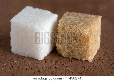 Cubes Of Brown And White Sugar On  Board Of Mahogany