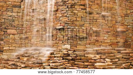 Water Cascading Over Stone Wall