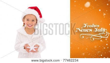 Festive little girl holding snowflake against orange vignette
