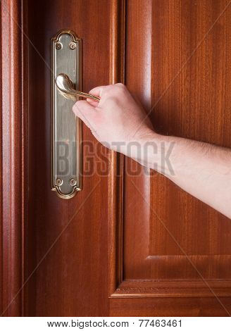 Hand Gripping The Handle Of A Door