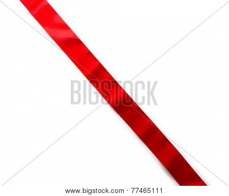 Extending simple red ribbon with typical ripples or wrinkles of a silky or satin ribbon , isolated on white. highlight on upper half.