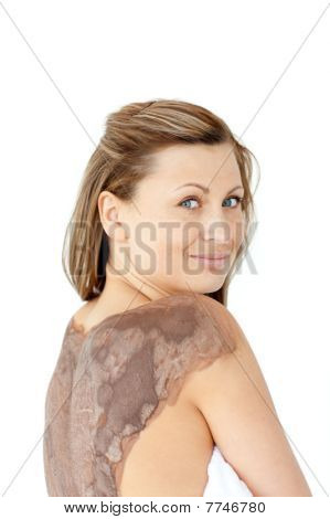 Portrait Of A Charming Woman Enjoying A Mud Skin Treatment