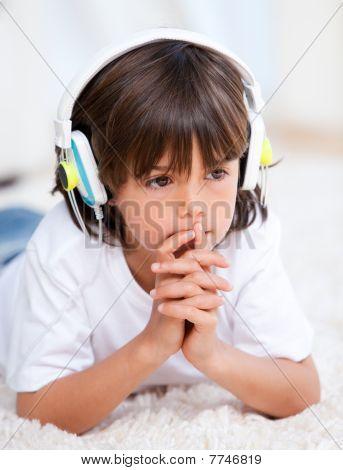 Pensive Boy Listening Music