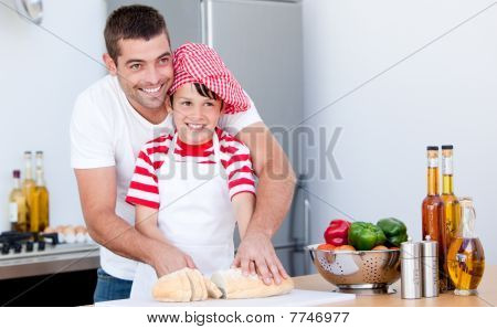 Portrait Of A Father And His Son Preparing A Meal