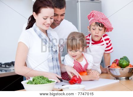 Portrait Of A Family Preparing A Meal
