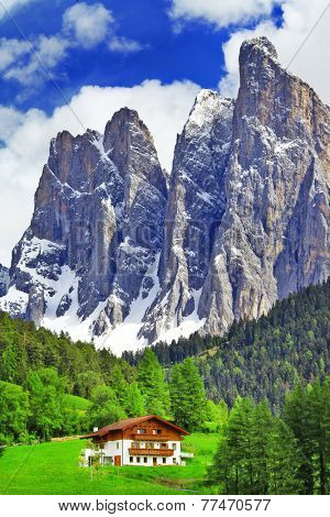 alpine scenery - wooden house in Dolomites, north of Italy