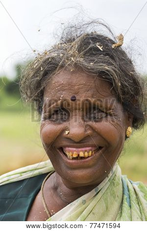 Older Woman Farmer With Bad Teeth.