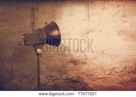 spot light on concrete wall, urban background, retro film filtered, instagram style