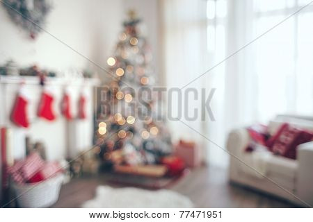 Beautiful holiday decorated room with Christmas tree, out of focus shot for photo background