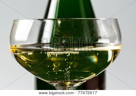 champagne bottle with champagne glass. photo icon for celebrations and new year.