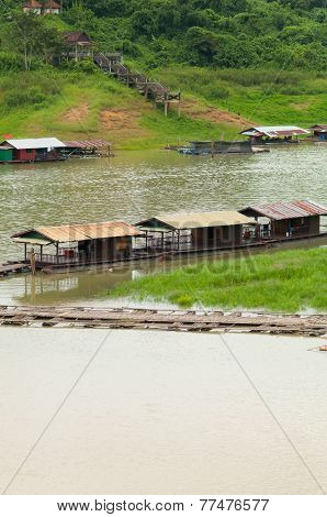 The Floating Village And Wooden Bridge In Sangkhlaburi, Kanchanaburi Province In Thailand