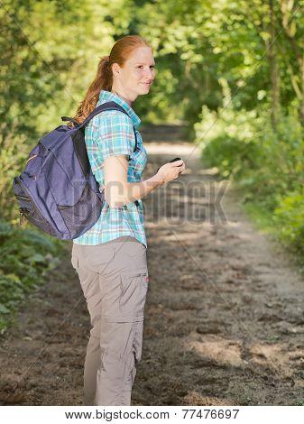 Hiker Navigating With Gps