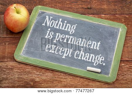 Nothing is permanent except change - words of wisdom on a slate blackboard against red barn wood