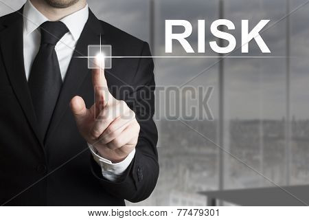 Businessman Pushing Button Risk