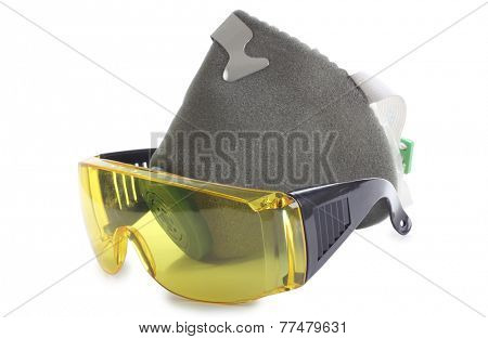 Work goggles and respirators on white background